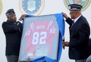 Star Group-Veterans Helping Veterans: Jon Robertson and Jonathan Haywood unveil a jersey from professional football player Joshua Boyce at the opening of the Star Group-Veterans Helping Veterans building Friday, Feb. 27, 2014, in downtown Copperas Cove. - Herald/CATRINA RAWSON