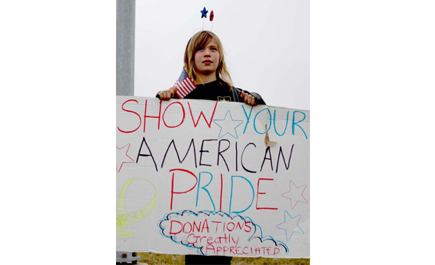 Girl holding sign