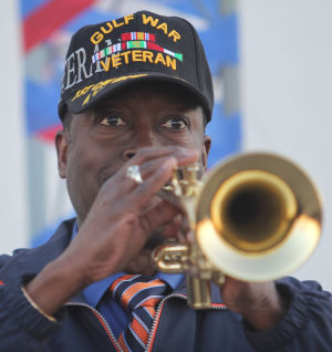 Star Group-Veterans Helping Veterans: Arthur L. Bryan, band director from Patterson Middle School, plays the trumpet during the opening of the Star Group-Veterans Helping Veterans building Friday, Feb. 27, 2014, in Copperas Cove. - Herald/CATRINA RAWSON