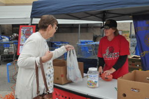 Make A Difference Day: Mollie Bersch of Copperas Cove hands food to Dorothy Lyons, director of the STAARZ basketball team's food drive Saturday, a Make A Difference Day project, at the Cove Walmart. - Picasa