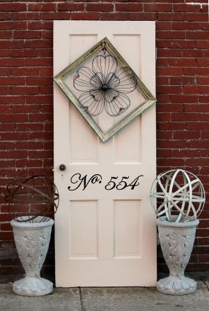 Front Door Decorations: With flowers blooming in the front of houses, the front door can use a makeover to make it fresh as well. Using a few simple items found cheap at antique or design stores can do the trick. - MICHAEL CHRITTON | Akron Beacon Journal