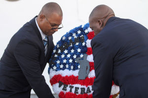 Star Group-Veterans Helping Veterans: Michael Barber, left, and Howard Hawk lay a wreath to celebrate the opening of the Star Group-Veterans Helping Veterans building Friday, Feb. 27, 2014, in Copperas Cove. - Herald/CATRINA RAWSON