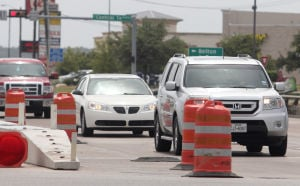 FM 2410 Construction: Traffic moves across the Farm-to-Market 2410 bridge as construction continues Monday in Harker Heights. On each side of the bridge, a 6-foot, 8 inch-wide pedestrian sidewalk will be added. - Herald/CATRINA RAWSON