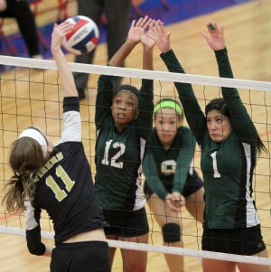 Ellison Vs Mansfield Volleyball: Ellison's Kaeleana Hattix-Covington (12) and Alysia Espada (1) go up for a block against Mansfield in their Class 5A bi-district playoff match Tuesday at Midway High School in Waco. - Herald/CATRINA RAWSON