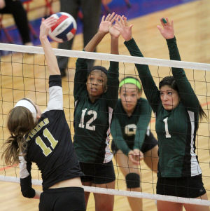 Ellison Vs Mansfield Volleyball: Ellison's Kaeleana Hattix-Covington (12) and Alysia Espada (1) go up for a block against Mansfield in their Class 5A bi-district playoff match Tuesday at Midway High School in Waco. - Photo by Herald/CATRINA RAWSON