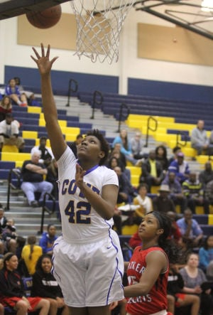 Cove V. Heights: Copperas Cove's Bryaunea Hall attempts a basket against Harker Heights Tuesday night at Copperas Cove. - Herald/MARIANNE GISH