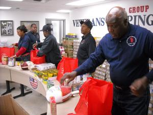<p>Volunteers with the Star Group-Veterans Helping Veterans put together Thanksgiving meal bags Wednesday, Nov. 12, 2014.</p>