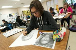 <p>Union Grove Middle School eighth-grade art students work on pencil self-portraits, which will be part of the huge Killeen ISD Visual Art Show set to open Monday at the Killeen Civic and Conference Center and run throughout the week.</p>