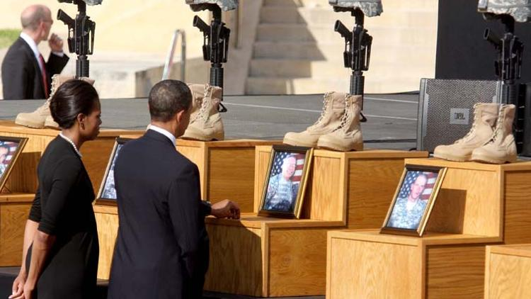 President Obama and First Lady pay respect