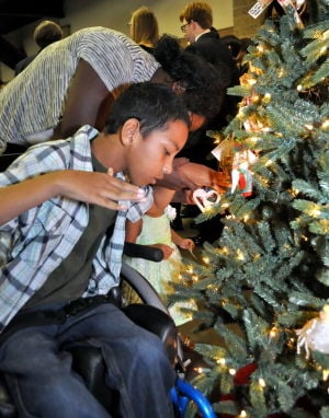 In Memoriam: Families, friends remember loved ones with angel tree