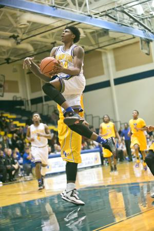 <p>Copperas Cove's Rashard Odomes drives in for a basket on Tuesday in Copperas Cove. Odomes finished with a triple-double —31 points, 15 rebounds and 11 assists —in the Bulldawgs' win over 4A-No. 17 Waco La Vega.</p>