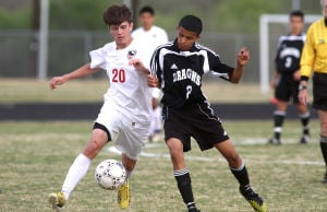 <p>Salado's Tristan Bragg battles Nacogdoches' Rudy Fuentes for the ball during playoffs Thursday evening at University High School in Waco.</p>