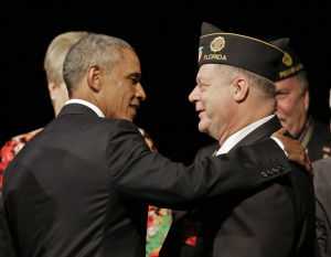 <p>President Barack Obama greets a Legionnaire after speaking at the American Legion national convention in Charlotte, N.C., Tuesday, Aug. 26, 2014. Three months after a veterans' health care scandal rocked his administration, President Barack Obama is taking executive action to improve the mental well-being of veterans. The president was to announce his initiatives during an appearance before the American Legion National Convention that is fraught with midterm politics.</p>