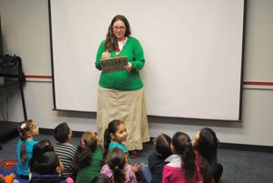 <p>Sherry Everett reads a book to a bilingual class Thursday, Dec. 18, 2014, at Trimmier Elementary School in Killeen.</p>