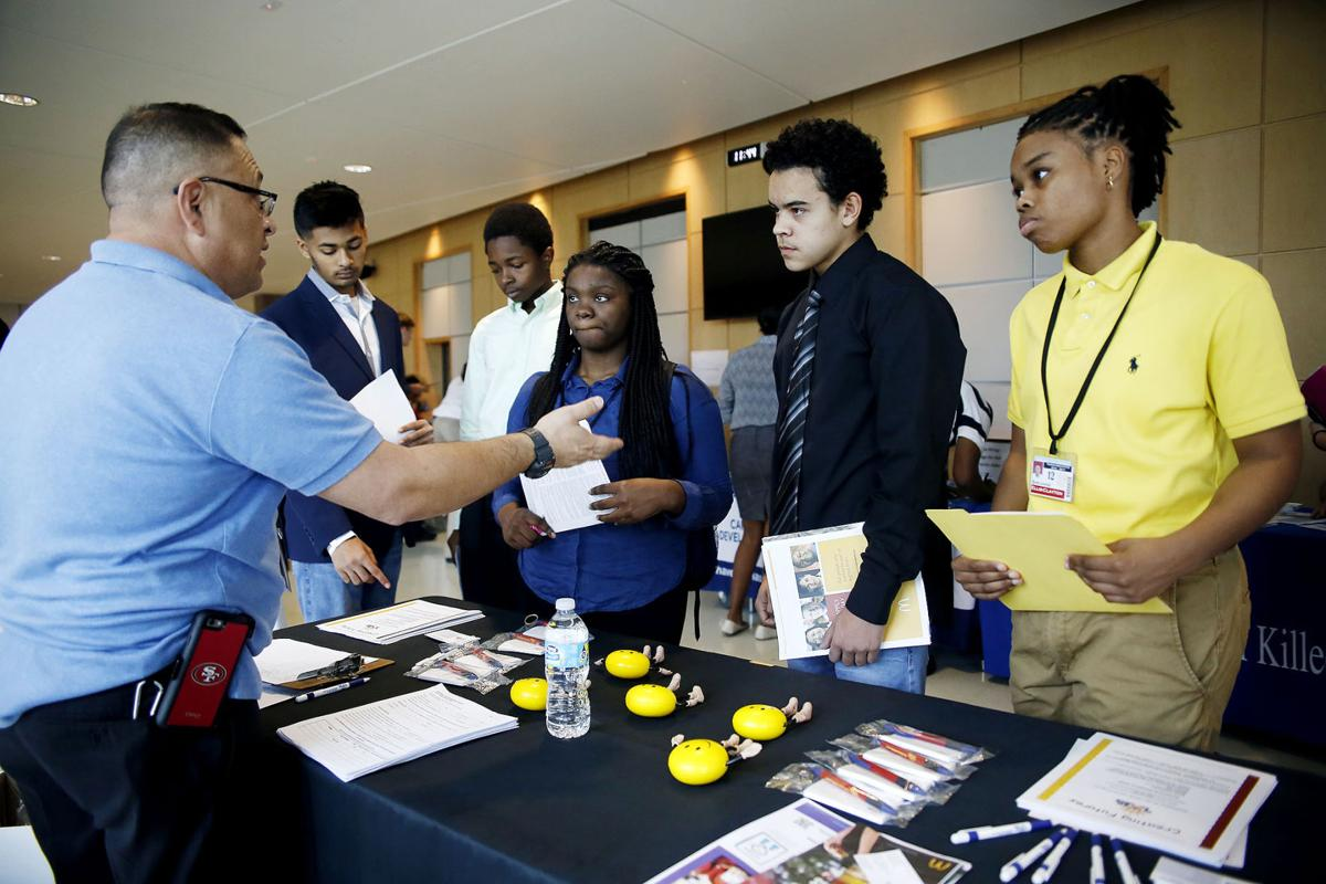 high school students look at possible careers at teen job fair career fair