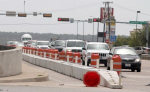 FM 2410 Construction: Traffic moves across the Farm-to-Market 2410 bridge as construction continues Monday in Harker Heights. On each side of the bridge, a 6-foot, 8 inch-wide pedestrian sidewalk will be added. - Photo by Herald/CATRINA RAWSON
