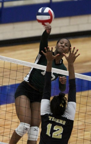 Ellison Vs Mansfield Volleyball: Ellison's Brianna Gray goes up for a hit against Mansfield in their Class 5A bi-district playoff match Tuesday at Midway High School in Waco. - Photo by Herald/CATRINA RAWSON