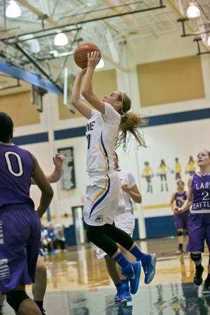 <p>Copperas Cove's Angel Mullen drives to the basket against San Marcos in the Bush's Chicken Holiday Classic on Friday at Copperas Cove.</p>