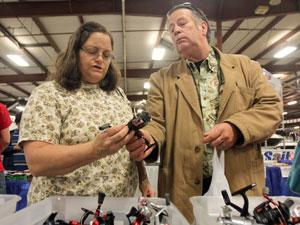 Adults, children cast bait at boat show