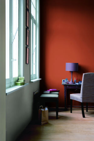 <p>Glidden's Crisp Autumn Leaves gives a moody, rich look to this room.</p>