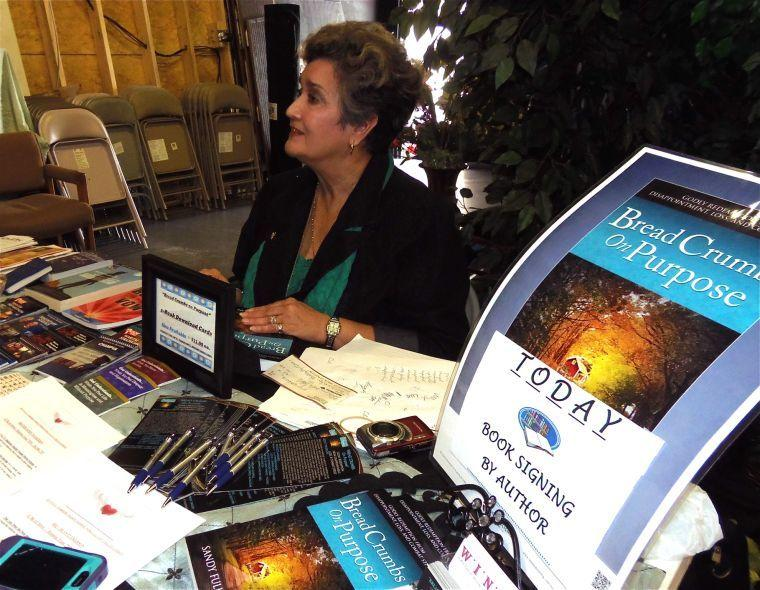 Author signs books