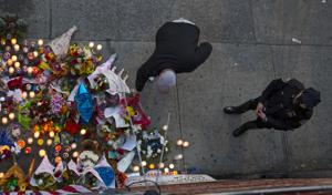 NYPD: Cop ambush killer told passers-by to watch