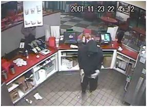 <p>In this photo distributed by the Harker Heights Police Department, a man is seen robbing the Freddy's Frozen Custard and Steakburgers in Harker Heights Sunday night. Both the Temple and Belton police departments have responded to aggravated robbery incidents in the previous week and there may be some similarities between the Harker Heights crime and some of these crimes, police said. Anyone with information is asked to contact these police departments or Crime Stoppers at 254-526-TIPS. The Harker Heights Criminal Investigations Division may be contacted at 254-953-5400.</p>