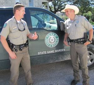County Game Wardens: Lampasas County game wardens Lance May, left, and Shaun Bayless talk Friday, Nov. 1, 2013, about their next deer camp visit. Deer rifle season started this weekend. - Photo by Tim Orwig | Herald Staff Writer