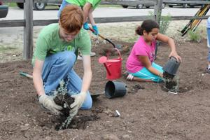 Volunteers help with garden