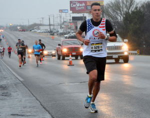 <p>Runners in the second annual Army Marathon make their way down Business U.S. Highway 190 on Sunday, March 2, 2014.</p>