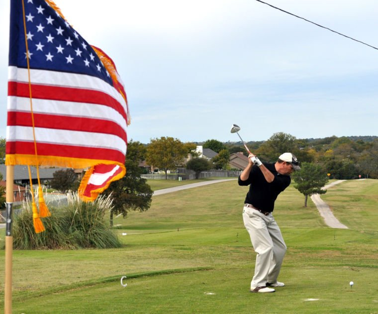 Golfers tee off for veterans, raise money for families in need