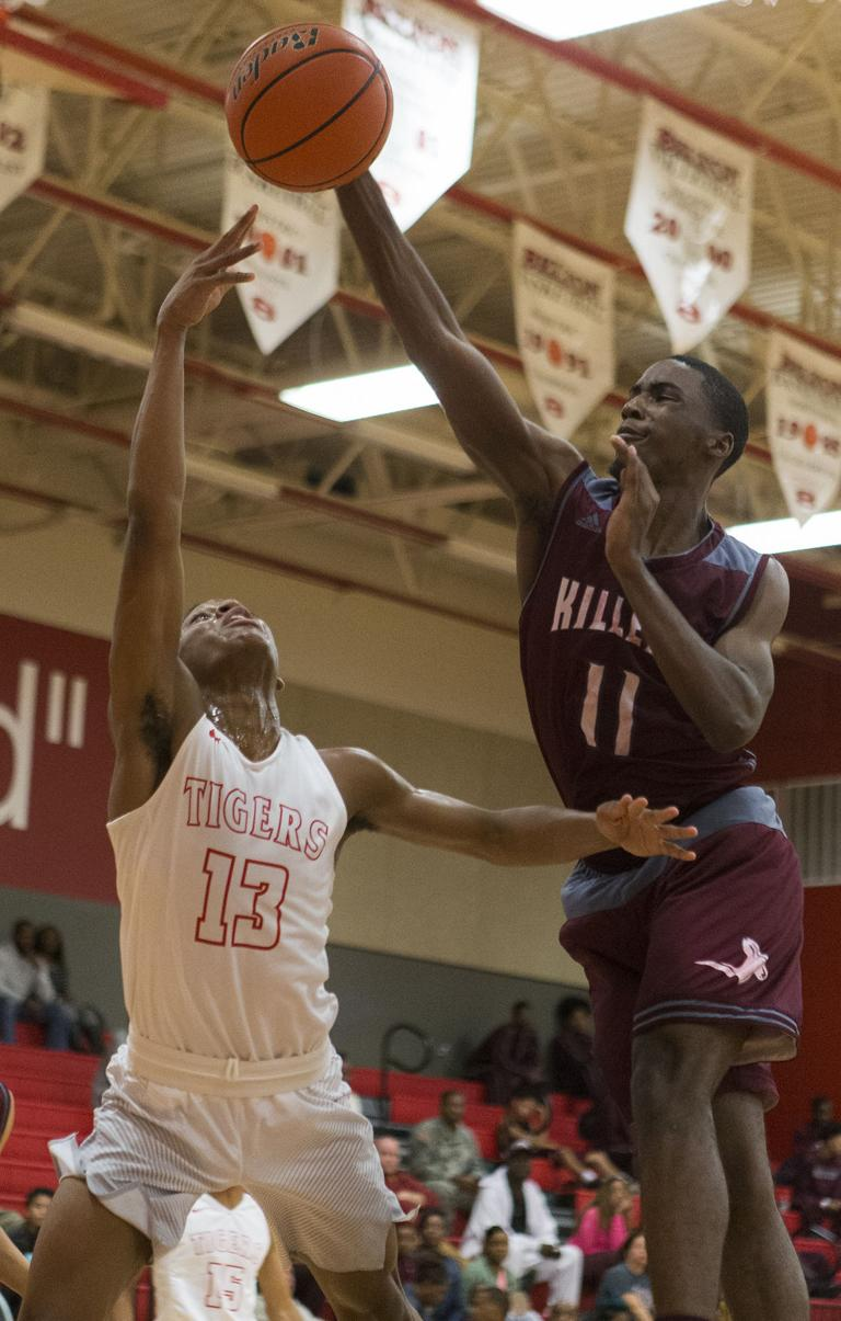 BOYS BASKETBALL: Roos hold off Belton 58-56 in 8-6A opener