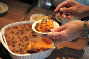 <p>A judge spoons a sample of the sweet potato casserole in the running for the new side dish for Cheddar's Scratch Kitchen side dish contest Tuesday afternoon at the restaurant in Harker Heights.</p>