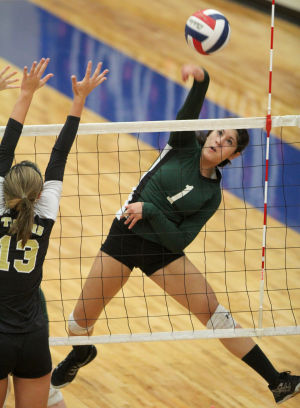 Ellison Vs Mansfield Volleyball: Ellison's Alysia Espada goes up for a hit against Mansfield in their Class 5A bi-district playoff match Tuesday at Midway High School in Waco. - Herald/CATRINA RAWSON
