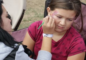 Octoberfest5.jpg: Emily Revis, 9, gets her face painted during the Octoberfest event Saturday at Carl Levin Park in Harker Heights. - Jaime Villanueva