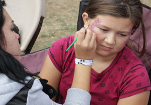 Octoberfest5.jpg: Emily Revis, 9, gets her face painted during the Octoberfest event  Saturday at  Carl Levin Park in Harker Heights. - Photo by Jaime Villanueva