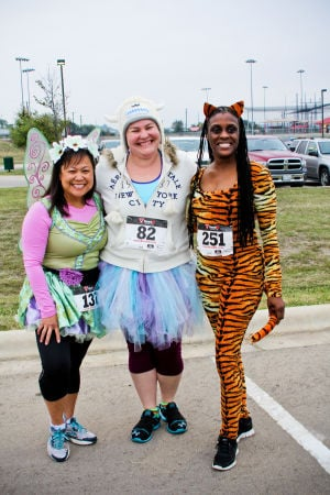 Monster Dash: Ruth Lee of Copperas Cove, left, poses for a photo with Ashley Crane of Waco, and Yvette Rowland of Killeen. The runners participated in the Monster Dash at Harker Heights Community Park on Saturday morning. - Photo by Jodi Perry | Herald