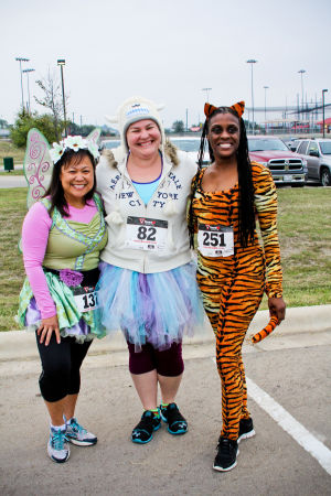 Monster Dash: Ruth Lee of Copperas Cove, left, poses for a photo with Ashley Crane of Waco, and Yvette Rowland of Killeen. The runners participated in the Monster Dash at Harker Heights Community Park on Saturday morning. - Jodi Perry | Herald