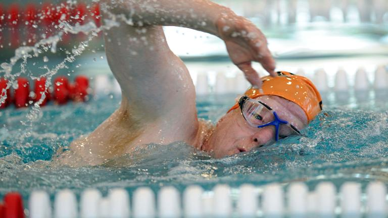Teacher swims to raise funds for cancer research