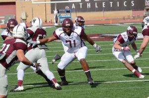 Terrance Harris: West Texas A&M left tackle Terrance Harris (71) moves against McMurry defenders Oct. 26 in Abilene. - Photo by Courtesy Of West Texas A&M Athletics