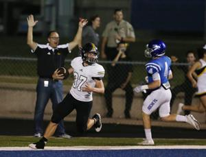 <p>Gatesville running back Alex Thompson (37) scores past Robinson's Brock Scott in the first half Friday in Robinson.</p>