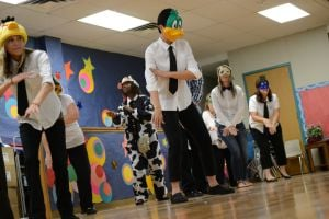 "<p>Cedar Valley Elementary School teachers sing ""What Does Your Teacher Say,"" a parodied version of ""What Does the Fox Say"" during a pep rally for third- through fifth-graders to motivate students to do their best on state testing Tuesday and today.</p>"