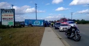 <p>Police work an accident scene Thursday at Trimmier Road and Atlas Avenue. A truck hit a boy riding a bicycle, police said.</p>