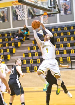 <p>Gatesville's Justin Massey (1) drives under the basket for a layup against Goldthwaite on Tuesday in a Hornet Holiday Classic contest in Gatesville.</p>