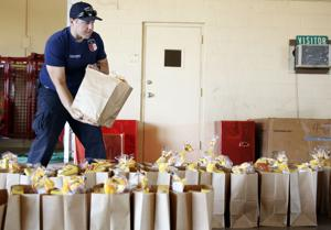 Heights FD, others pack Thanksgiving bags for families