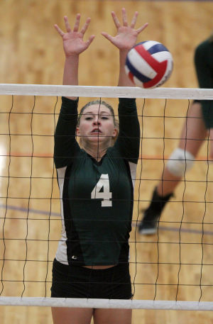 Ellison Vs Mansfield Volleyball: Ellison's Bailey Wade goes up for a block against Mansfield in their Class 5A bi-district playoff match Tuesday at Midway High School in Waco. - Herald/CATRINA RAWSON