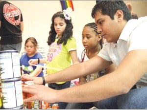 Students from CTC, Maxdale Elementary help food pantry by building things out of canned goods