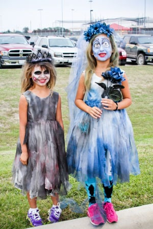 Monster Dash: Young girls came dressed in costume Saturday for the Monster Dash in Harker Heights. - Jodi Perry | Herald