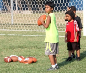 <p>Keoni Mandobon prepares to throw a pass during the annual Punt, Pass and Kick competition for the youth of Central Texas on Saturday, Sept. 7, 2013, in Copperas Cove.</p>