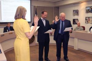 Terry Delano and Marvin Rainwater take oath